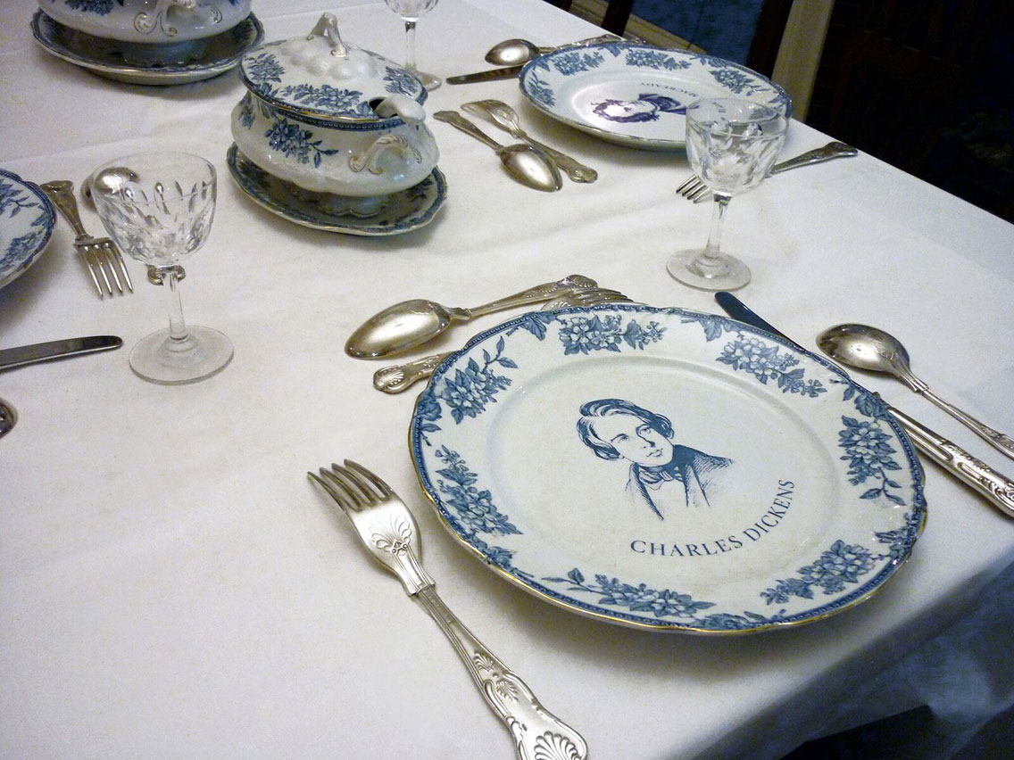 The fully set table recreated in one of the period rooms at the Charles Dickens Museum, London