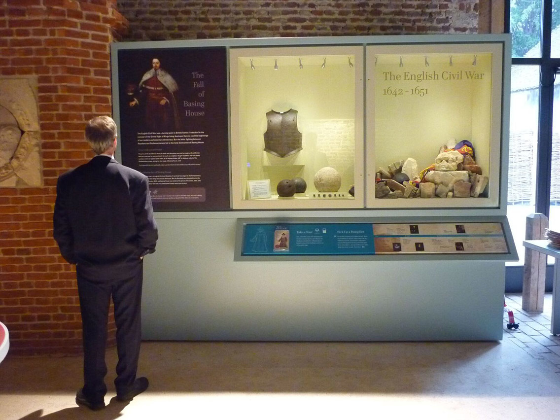 Museum exhibits on show to visitors learning about the English Civil War and fall of Basing House